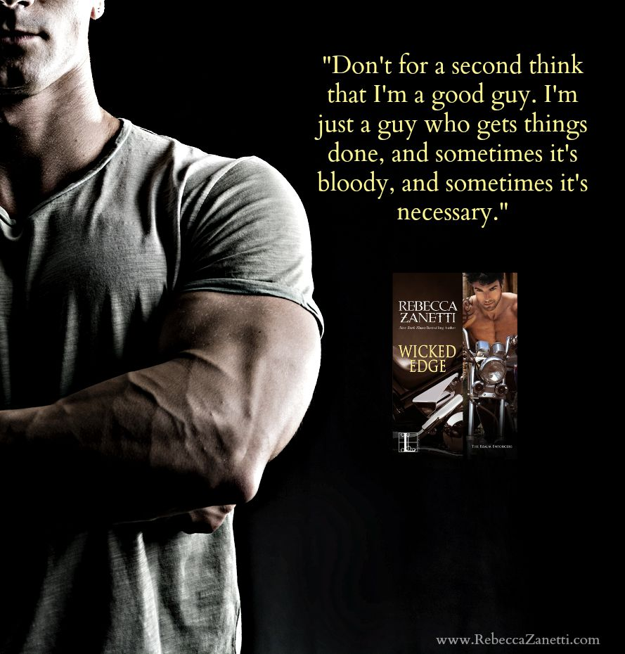 Handsome muscular fit young man on dark background looking at camera, arms crossed on his chest