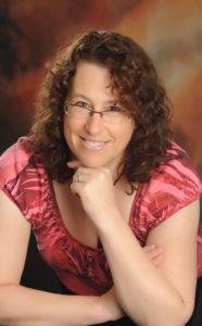 professional head shot of Tamara Hughes